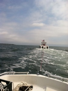 Capt. Brian of TowBoat US New Bedford towing the Little Water Buggy.